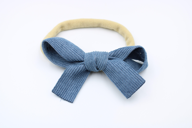 Haarbandje naturel met blauwe rib strik