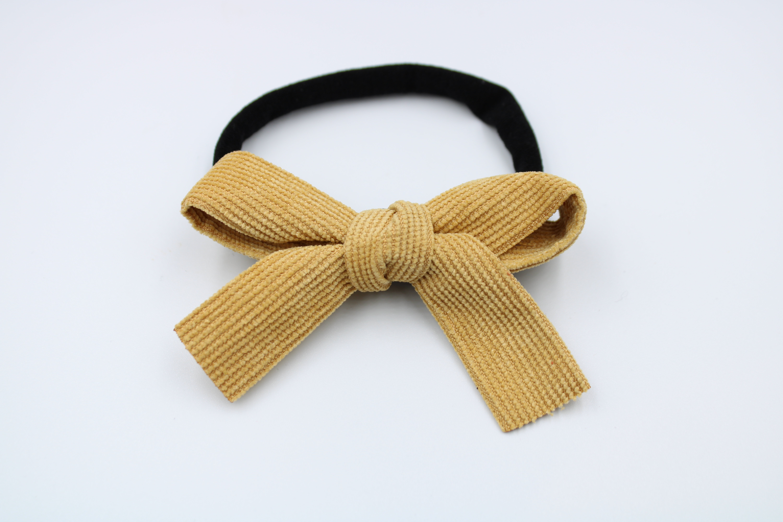 Haarbandje zwart met camel rib strik